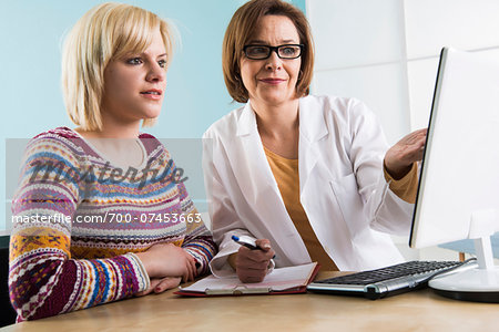 Mature Doctor with Patient in Doctor's Office Stock Photo - Rights-Managed, Image code: 700-07453663
