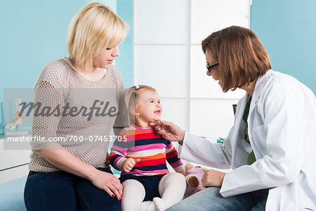 Doctor with Baby Girl and Mother in Doctor's Office Stock Photo - Rights-Managed, Image code: 700-07453705