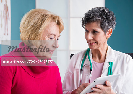 Doctor talking with Senior Patient in Doctor's Office Stock Photo - Rights-Managed, Image code: 700-07487577