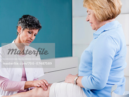 Doctor Examining Senior Patient in Doctor's Office Stock Photo - Rights-Managed, Image code: 700-07487589