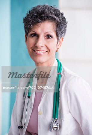 Portrait of Doctor with Stethoscope in Doctor's Office Stock Photo - Rights-Managed, Image code: 700-07487614
