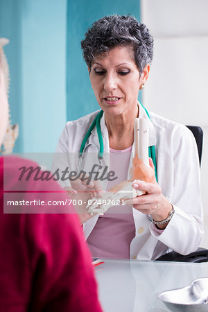 Doctor talking with Teenage Patient in Doctor's Office Stock Photo - Rights-Managed, Image code: 700-07487621