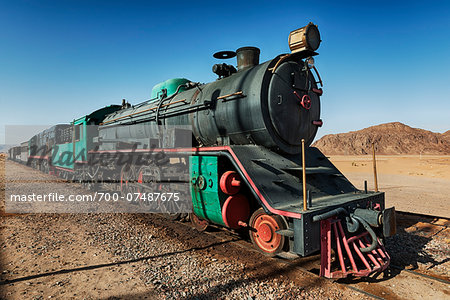 Old steam train on tracks in desert, Wadi Rum, Jordan Stock Photo - Rights-Managed, Image code: 700-07487675