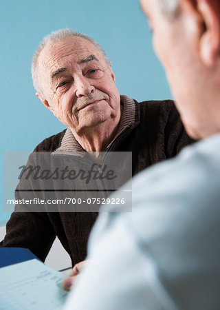 Senior male patient consulting doctor in office, Germany Stock Photo - Rights-Managed, Image code: 700-07529226