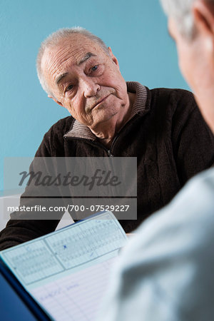 Senior male patient consulting doctor in office, Germany Stock Photo - Rights-Managed, Image code: 700-07529227