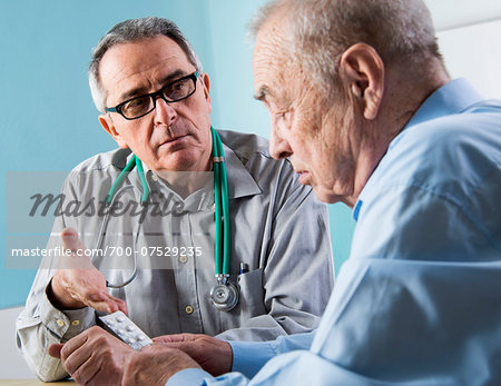 Senior, male doctor conferring with senior, male patient in office, discussing medication, Germany Stock Photo - Rights-Managed, Image code: 700-07529235