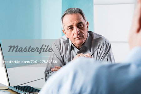 Senior, male doctor conferring with male patient in office, Germany Stock Photo - Rights-Managed, Image code: 700-07529236