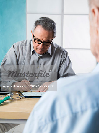 Senior, male doctor conferring with male patient in office, Germany Stock Photo - Rights-Managed, Image code: 700-07529239