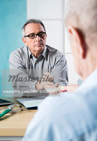 Senior, male doctor conferring with male patient in office, Germany Stock Photo - Rights-Managed, Image code: 700-07529241