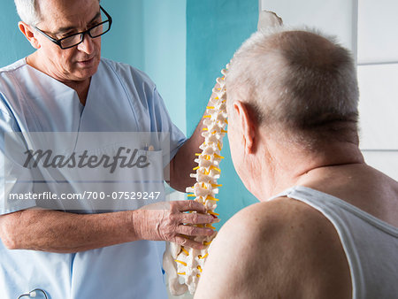Senior, male doctor discussin spinal cord with senior, male patient, in office, Germany Stock Photo - Rights-Managed, Image code: 700-07529247