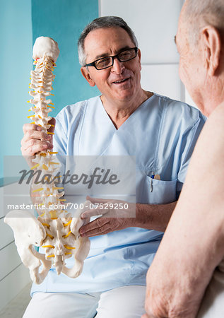 Senior, male doctor discussin spinal cord with senior, male patient, in office, Germany Stock Photo - Rights-Managed, Image code: 700-07529250