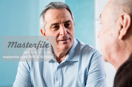 Senior, male doctor conferring with senior, male patient in office, Germany Stock Photo - Rights-Managed, Image code: 700-07529262