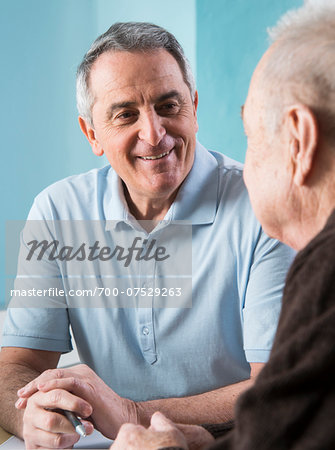 Senior, male doctor conferring with senior, male patient in office, Germany Stock Photo - Rights-Managed, Image code: 700-07529263