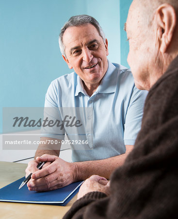 Senior, male doctor conferring with senior, male patient in office, Germany Stock Photo - Rights-Managed, Image code: 700-07529266