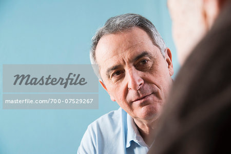 Close-up of senior, male doctor conferring with senior, male patient in office, Germany Stock Photo - Rights-Managed, Image code: 700-07529267