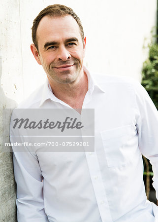 Portrait of man wearing white dress shirt outdoors, smiling and looking at camera, Germany Stock Photo - Rights-Managed, Image code: 700-07529281