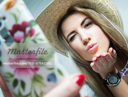 Young Woman taking Selfie, Studio Shot Stock Photo - Rights-Managed, Image code: 700-07562382