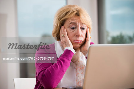 Senior woman working on notebook computer, Germany Stock Photo - Rights-Managed, Image code: 700-07584787