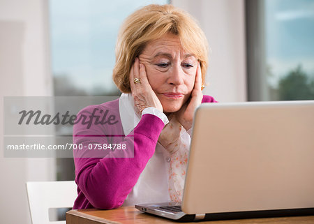 Senior woman working on notebook computer, Germany Stock Photo - Rights-Managed, Image code: 700-07584788