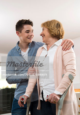 Teenage boy helping Grandmother using cruthces at home, Germany Stock Photo - Rights-Managed, Image code: 700-07584809
