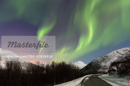 Northern Lights (Aurora Borealis) above Road and Snow Covered Mountains in Arctic, Troms, Norway Stock Photo - Rights-Managed, Image code: 700-07636918