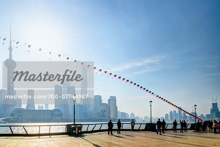Kite flying along the promenade at The Bund with view of Pudong skyline, Shanghai, Shanghai Shi, Zhonghua, China
