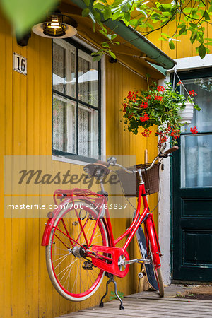 Bicycle parked at entrance of home in Vaxholm near Stockholm, Sweden Stock Photo - Rights-Managed, Image code: 700-07783857