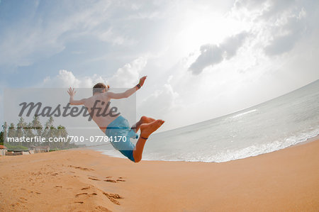 Boy Jumping in Air, Negombo Beach, Negombo, Western Province, Sri Lanka Stock Photo - Rights-Managed, Image code: 700-07784170
