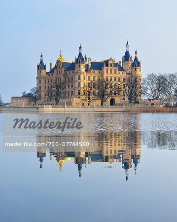 Schwerin Castle reflected in Schwerin Lake, Schwerin, Western Pomerania, Mecklenburg-Vorpommern, Germany Stock Photo - Rights-Managed, Image code: 700-07784580