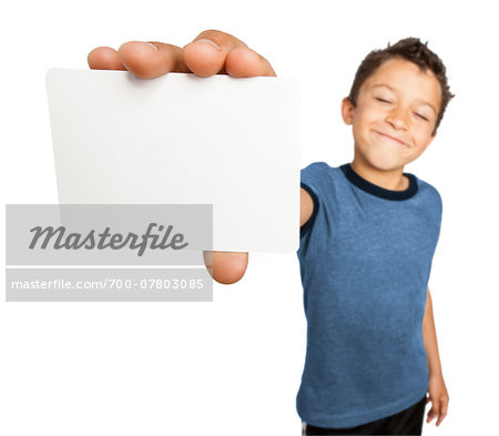 Boy holding a blank card close to camera, studio shot on white background Stock Photo - Rights-Managed, Image code: 700-07803085