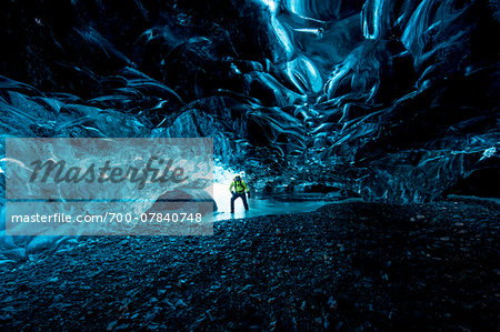 Interior of Ice Cave with Mountain Guide, Iceland Stock Photo - Rights-Managed, Image code: 700-07840748