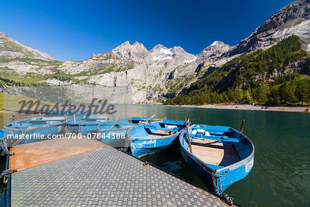 Blue rowing boats in front of the steep mountains of the Bluemlisalp Mountain Range at Lake Oeschinensee, Kandersteg, Jungfrau-Aletsch, UNESCO World Heritage Site, Canotn of Bern, Switzerland Stock Photo - Rights-Managed, Image code: 700-07844388