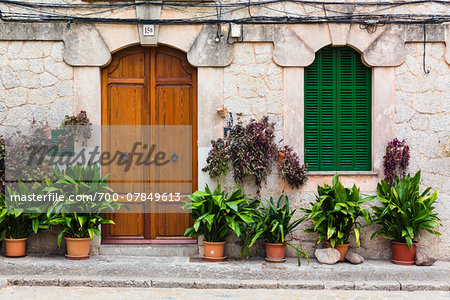Houses along an alley of the picturesque mountain village Valldemossa, Tramuntana Mountains, Majorca, Balearic Islands, Spain Stock Photo - Rights-Managed, Image code: 700-07849613