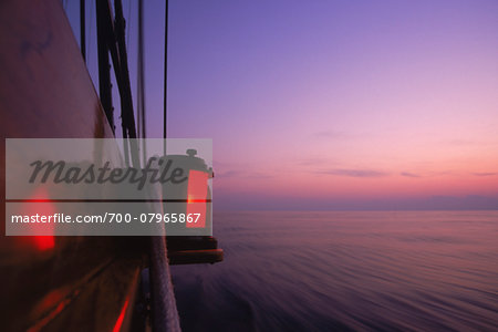 Detail of Port Navigation Running Light at Dawn aboard Schooner, Treee of Life Stock Photo - Rights-Managed, Image code: 700-07965867