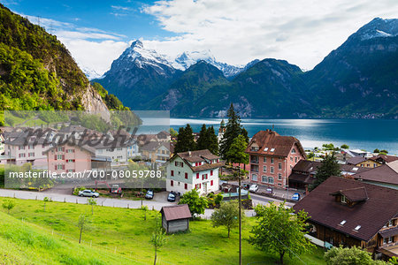 Alpine Village of Sisikon at Tellsplatte at Urnersee in front of Mount Gitschen and Urirotstock still Snow Covered, Canton of Uri, Switzerland Stock Photo - Rights-Managed, Image code: 700-08059788