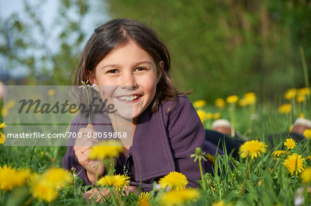 Close-up of Girl Lying in Meadow in Spring, Upper Palatinate, Bavaria, Germany Stock Photo - Rights-Managed, Image code: 700-08059858