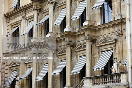 Building with Awnings over Windows, Paris, France Stock Photo - Rights-Managed, Image code: 700-08059887