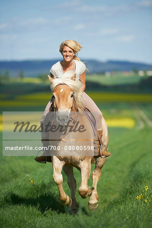 Young woman riding a Haflinger horse in spring, Bavaria, Germany Stock Photo - Rights-Managed, Image code: 700-08080598
