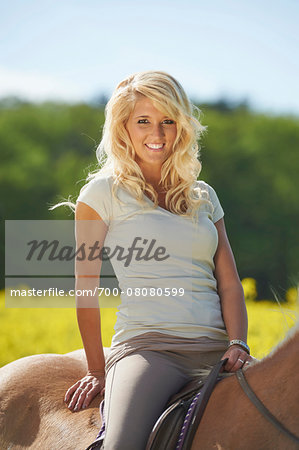 Close-up portrait of a young woman sitting on a Haflinger horse in spring, Bavaria, Germany Stock Photo - Rights-Managed, Image code: 700-08080599