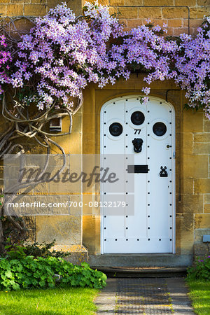 Close-up of doorway with flowering vine, Broadway, Worcestershire, The Cotswolds, England, United Kingdom Stock Photo - Rights-Managed, Image code: 700-08122179