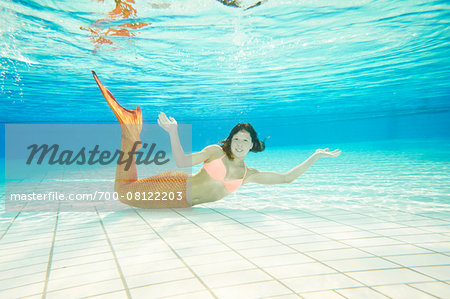 Portrait of Teenage Girl with Mermaid Tail Underwater Stock Photo - Rights-Managed, Image code: 700-08122203