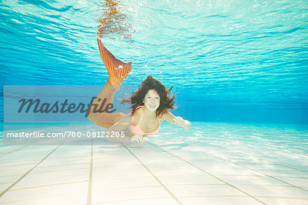 Portrait of Teenage Girl with Mermaid Tail Underwater Stock Photo - Rights-Managed, Image code: 700-08122205