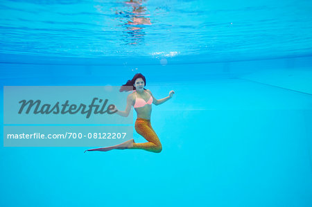 Portrait of Teenage Girl with Mermaid Tail Underwater Stock Photo - Rights-Managed, Image code: 700-08122207