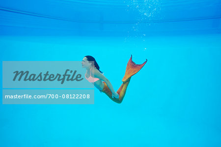 Portrait of Teenage Girl with Mermaid Tail Underwater Stock Photo - Rights-Managed, Image code: 700-08122208