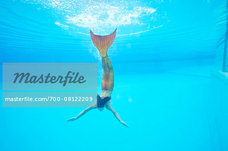 Portrait of Teenage Girl with Mermaid Tail Underwater Stock Photo - Rights-Managed, Image code: 700-08122209