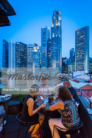 People at Bar at Boat Quay overlooking Skyline at Dusk, Singapore Stock Photo - Rights-Managed, Image code: 700-08167182