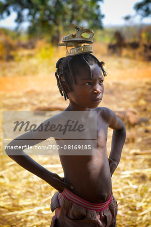Portrait of girl carrying sandals on her head, near Gaoua, Poni Province, Burkina Faso Stock Photo - Rights-Managed, Image code: 700-08169185