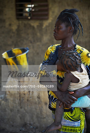 Mother holding child in arms while nursing, black and yellow patterns, Gaoua, Poni Province, Burkina Faso Stock Photo - Rights-Managed, Image code: 700-08169189