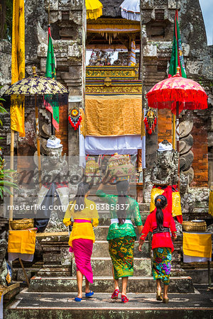 People carrying religious offerings, Temple Festival, Petulu, near Ubud, Bali, Indonesia Stock Photo - Rights-Managed, Image code: 700-08385837