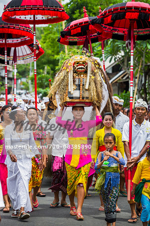 People carrying Sacred Barongs in a parade at a temple festival in Petulu Village, near Ubud, Bali, Indonesia Stock Photo - Rights-Managed, Image code: 700-08385890